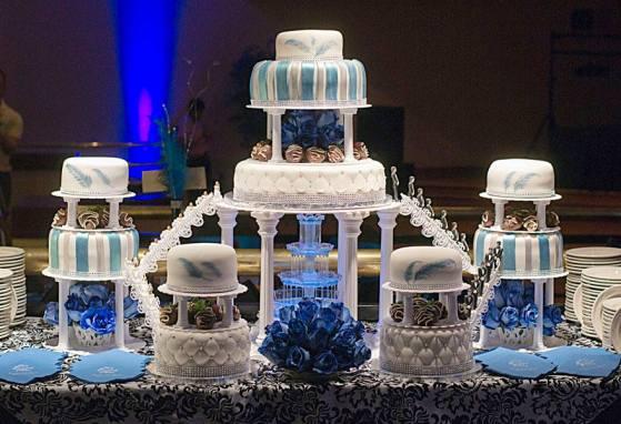 A blue seven tier cake