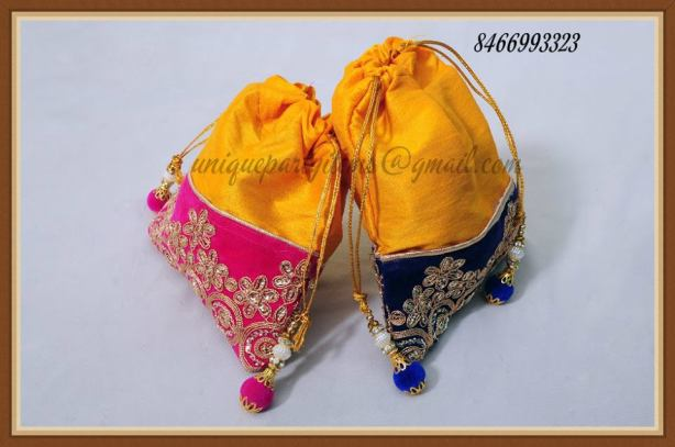Yellow Potli bags from Kaira Gift world