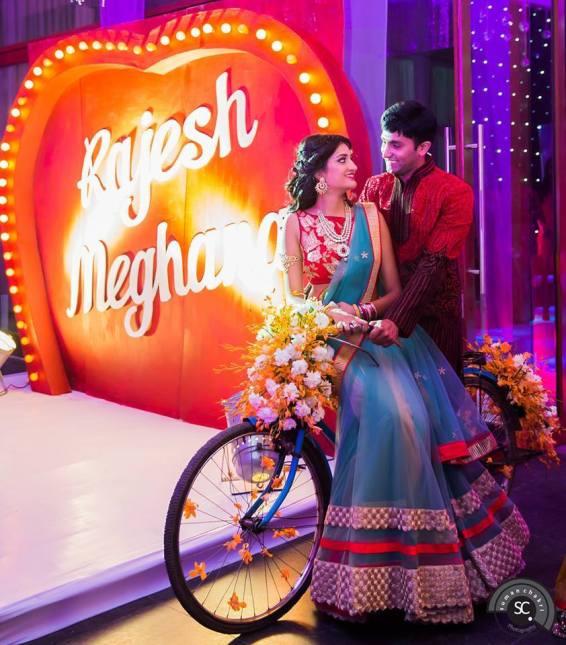 Bride groom posing on a cycle