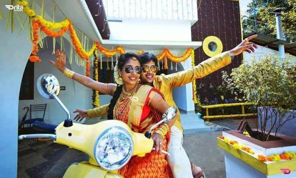 Bride and groom on a vespa