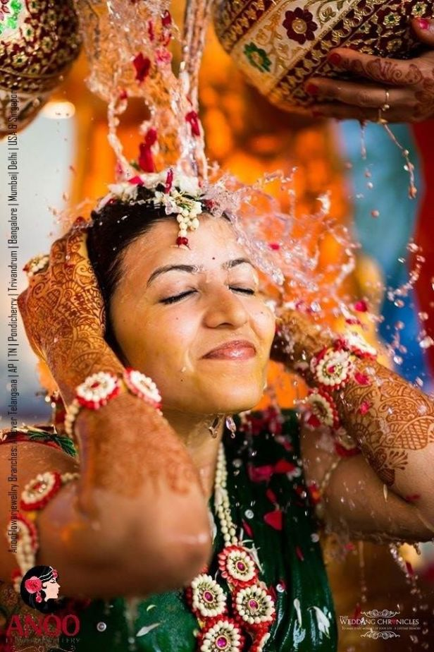 Bride wearing floral jewellery for mangala snanam