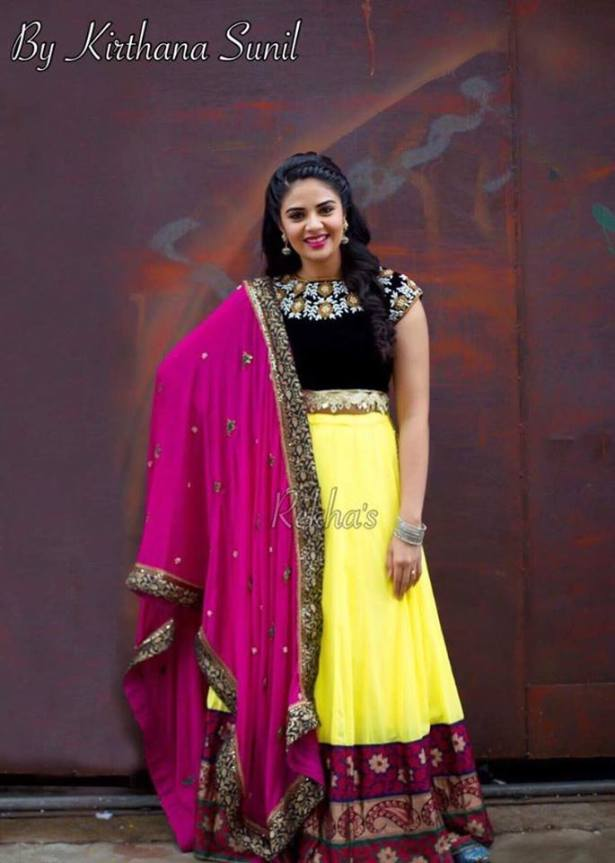 Sreemukhi in a yellow and pink outfit