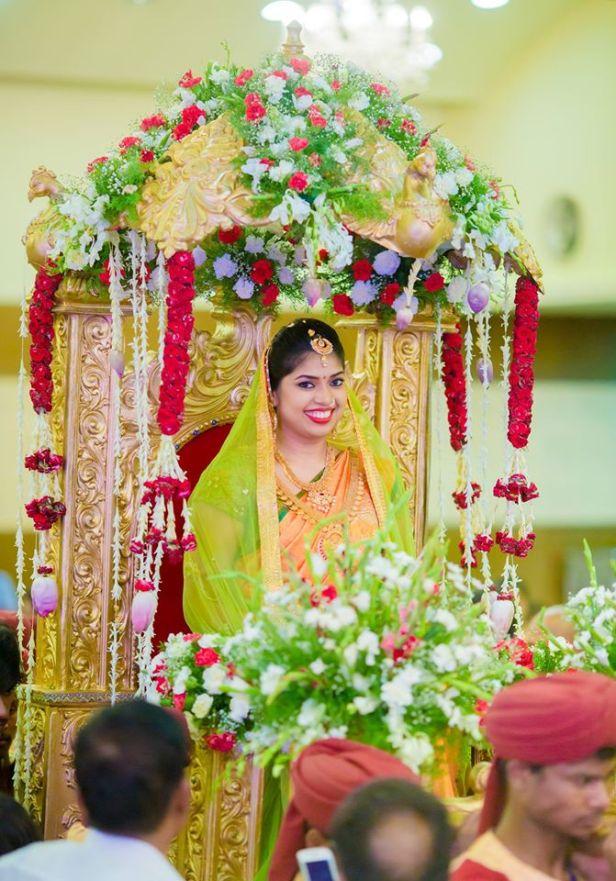 Pallaki and floral decor arrangement by EthicsEvents