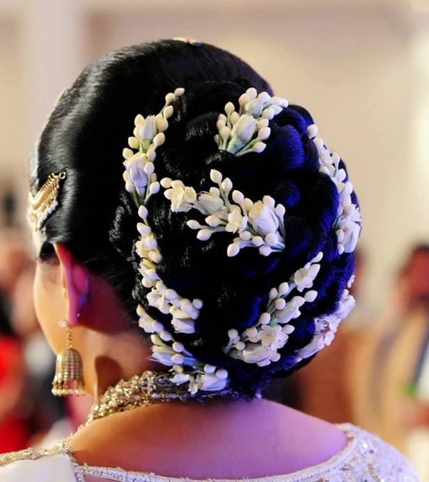For the love of Chic hair buns and white flowers.