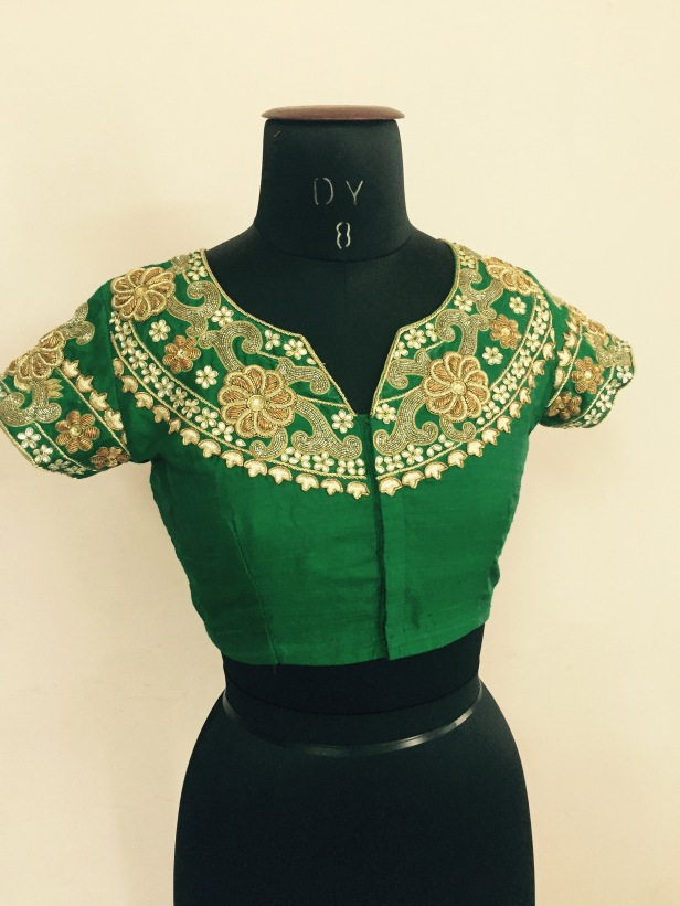 Green colored High neck blouse