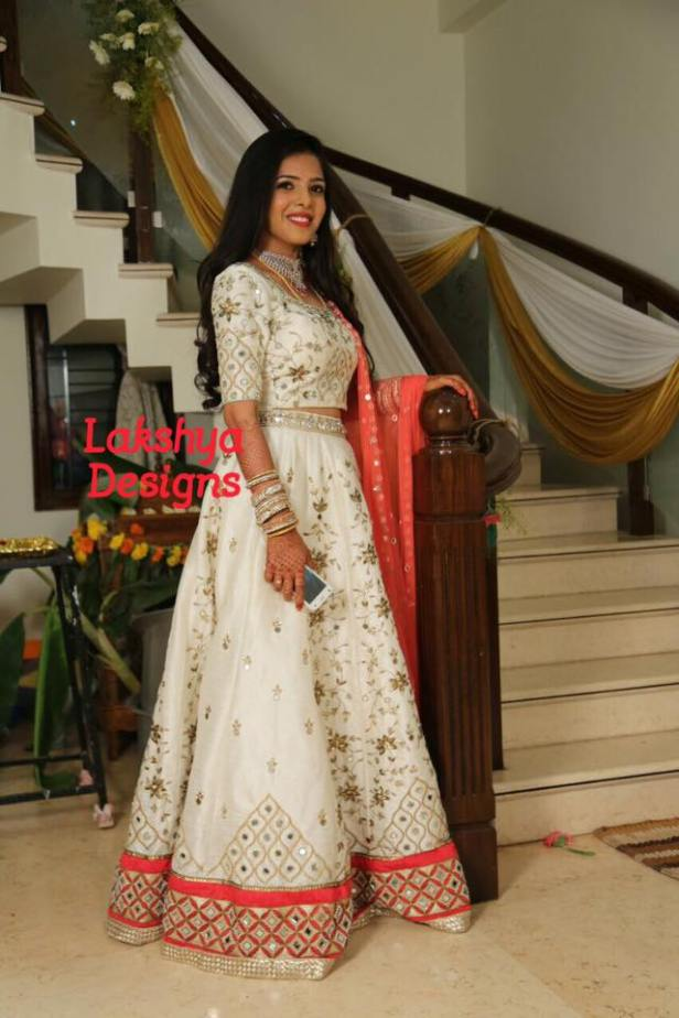 A white and coral lehenga for a bride