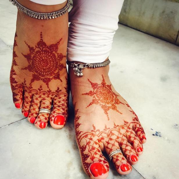 The Sun kissed feet with Mandala design