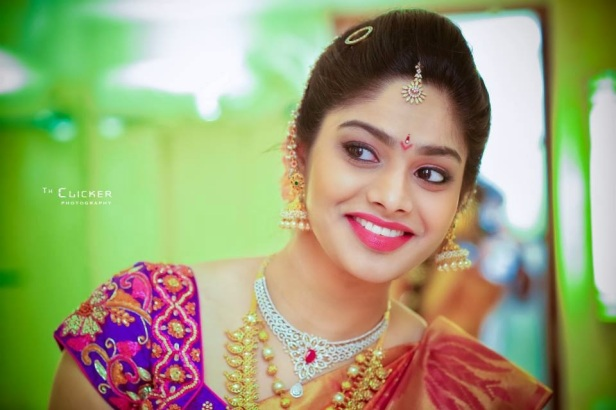 A bride wearing Surya Prabha