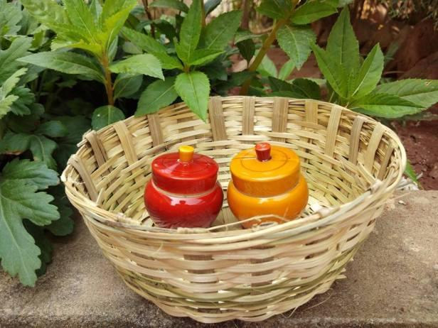 Wooden haldi kumkum boxes in a handwoven basket