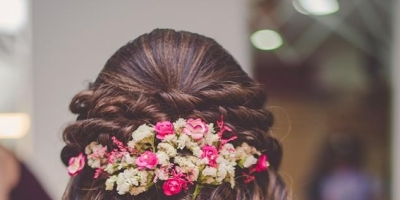 messy curls with contrast florals